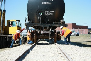 Workers align the rail car with the trucks. If it is not aligned, the trucks will be crushed and ruined, said fire service training assistant coordinator James Craft.