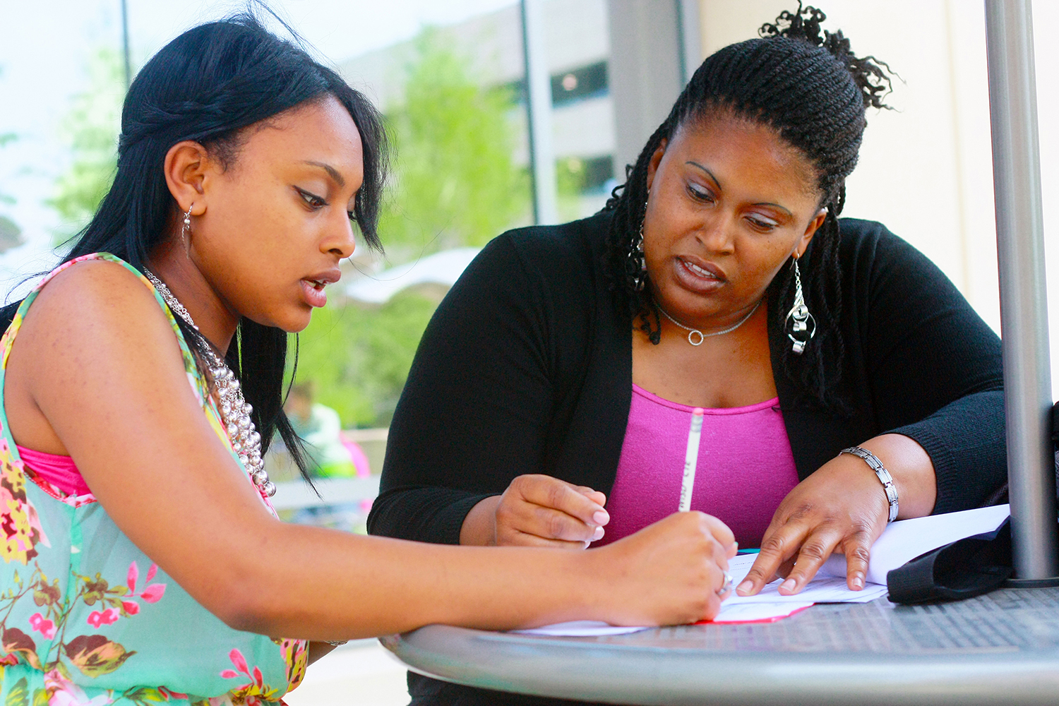 Faith Alexander and her mother LaTesha Alexander do homework outside of TR Campus. LaTesha is one of many single mothers who attend TCC. Photo by Carrie Duke/The Collegian