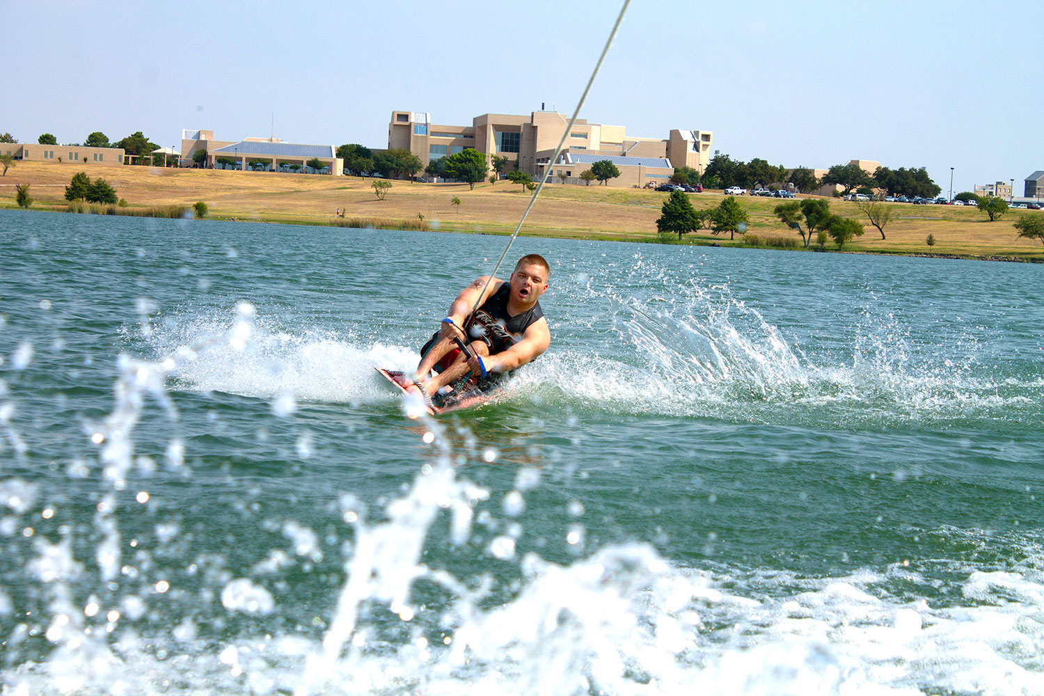 Lake Fest participant Mark Turner water skis on Marine Creek Lake near NW Campus Sept. 7. Lake Fest is an event where disabled people can use adaptive watersports equipment to have a fun day on the water.  Photo by Yesenia Santillan/The Collegian