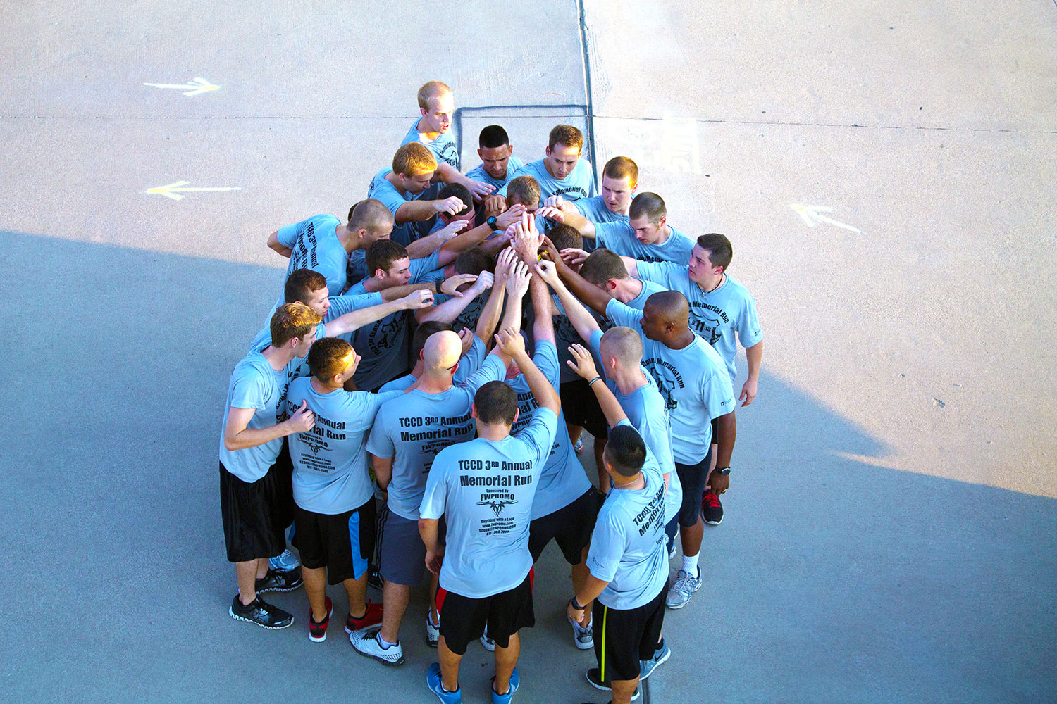 A firefighter academy platoon from the NW Fire Service Training Center huddles after participating in the Memorial Run on Sept. 11. Police cadets and TCC faculty also participated in the run in remembrance of the 9/11 attacks that occurred 12 years ago.  Photo by Yesenia Santillan/The Collegian