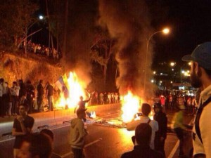 Photo courtesy Maria Artiles  Students protest in the streets of Tachira, Venezuela, where friends and family of South student Maria Artiles live. Protests turned violent after opposition leader Leopoldo Lopez turned himself in to authorities.