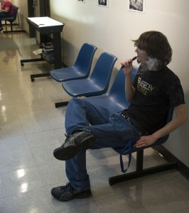 Jason Floyd/The Collegian  NE student Nick Rhoades smokes his electronic cigarette in a hallway. Currently, TCC policy only forbids tobacco use on campus, not electronic cigarettes.