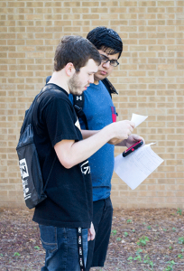NE students Sunny Ali and Zach Rojas search for classes. Katelyn Townsend/The Collegian.