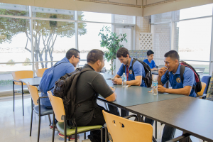 From left, Alex Benegas, Israel Sepulveda, Osvaldo Lopez and Efren Espino share some laughs in the NW Campus cafeteria before their first-day class begins.  Eric Rebosio/The Collegian