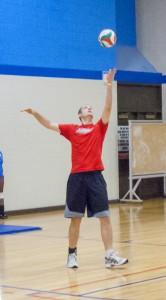 Trevor Vanderwerken, right, prepares to serve for the SE team.