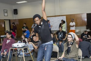 Da'Ron Samson celebrates his progression to the next round as his opponents sit in disbelief during South Campus' inaugural Super Smash Bros. gaming tournament on April 2.  Photo by Bogdan Sierra Miranda/The Collegian