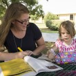 NE student Sarah Williams works in study time while her daughter Braelyn colors. Photo by Katelyn Townsend/The Collegian