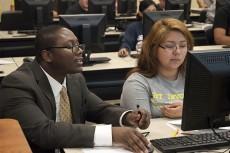 TR computer science professor and Chancellor's Award winner Tyson McMillan helps student Nancy Valdez.Audrey Werth/The Collegian