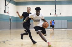 Free Agents team member Ezekiel Ogunniran rushes past opposing team member Bibiano Prado during the basketball championship game on SE Campus.Photos by Christina Feyisetan/The Collegian