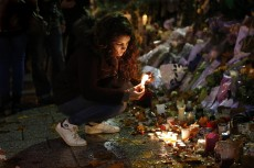 Candles are lit in honor of those who died after the attacks in Paris Nov. 20. The attacks occurred throughout Paris, including the Bataclan theater, where a concert was being held.