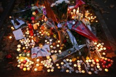 Candles, flowers and notes are placed around the city of Paris in remembrance of those who died during the attacks, which left at least 130 people dead.Photos by Carolyn Cole/Los Angeles Times/MCT