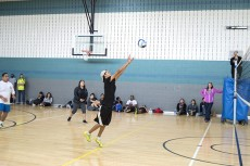 Student Diel Moreno reaches to set the ball during SE's volleyball tournament Nov. 6.Christina Feyisetan/The Collegian