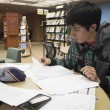NE Campus student Adrian Flores sits in the library and looks over his notes for class.Bogdan Sierra Miranda/The Collegian