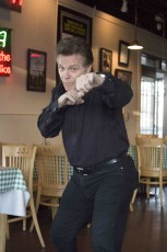 South student Dennis O'Neill, a Brooklyn native, shows off some skills in a pizzeria in Fort Worth.Bogdan Sierra Miranda/The Collegian