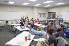 Members of South Campus' Script literature and art journal review submissions for its special 30th anniversary issue. The issue will feature work from current and former students and faculty. Prakash Sedhain/The Collegian