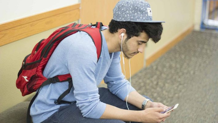 Mohammad Al-Saad listens to his favorite music as he waits for his next class to begin while on SE Campus.Bogdan Sierra Miranda/The Collegian