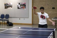 NE student Hoang Ta shows off his strong pingpong serve during the April 27 NE Campus tournament.Joshua West/The Collegian