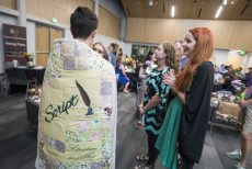 South student Amanda Fralicks, right, talks with faculty editor Logen Cure bundled in a quilt. The quilt was used on the cover of the 30th anniversary issue of Script. Photos by Peter Matthews/The Collegian