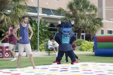 SE student Zach Lents begins a game of twister against TCC's mascot Toro.  Photo by Hayden Posey/The Collegian