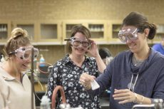 NE Chancellor's Award winner Susan Patrick monitors students Jessica Justice and Tracey Young in the lab while they synthesize aspirin in one of her chemistry courses.   Photos by Bogdan Sierra Miranda/The Collegian