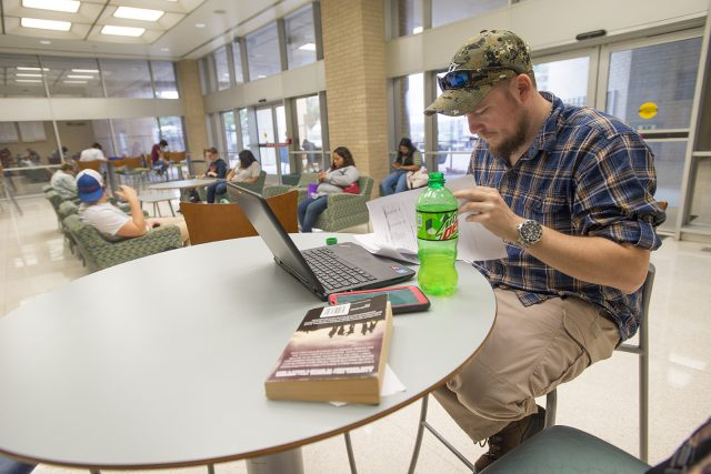 NW student Collin Hart reviews the syllabus for his sociology class in WTLO while waiting to head to his next class.