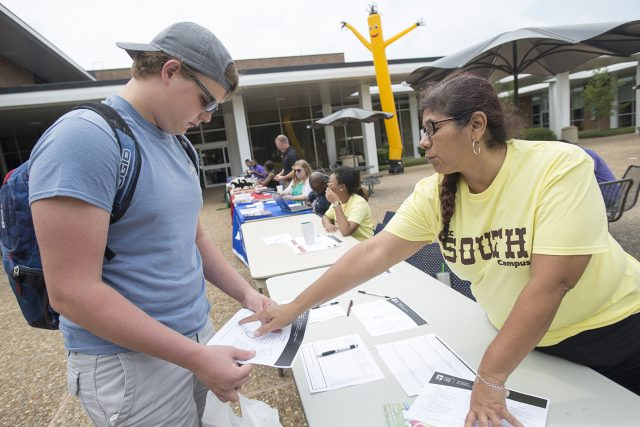 First-time college student Damain Doubrava, a South student, receives advice from transfer coordinator Sandra Bermejo during South Campus' Howdy Week.