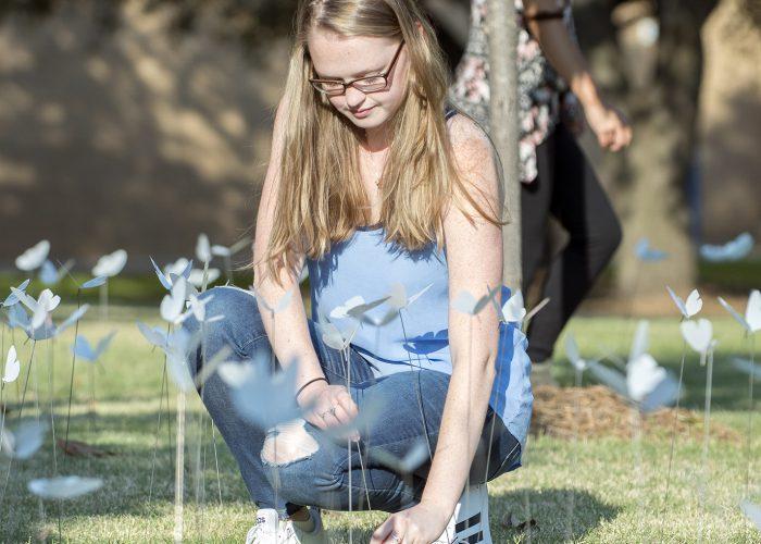 NE student Adrienne Echols checks on the butterflies during a class Sept. 18.