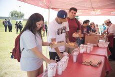 NW students Kayla Martinez, David Tapia and Juan Meza pick up free lunches, including hamburgers and drinks provided by In-N-Out for Northwest Fest Sept. 7.