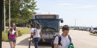 South students walk past the bus stop Sept. 30. South is one of three TCC campuses on The T's routes. Student input is being sought by the district as it looks to make transportation more accessible for students.