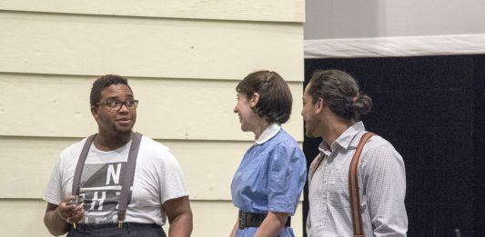 Rickie Jones, playing the role of Jim Bayliss, talks with castmates Sarah Adams, who plays Annie Deever, and Tomas Moquete, who plays Chris Keller, during a scene from the family-oriented play All My Sons.