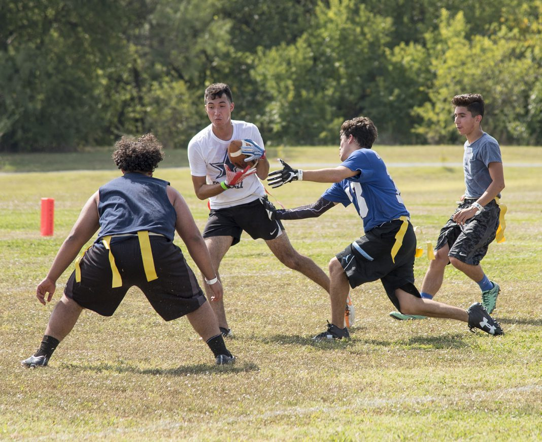 Omar Campos carries the ball down field in the game where Got Rice? beat TMS 37-27.