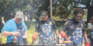 TCC police Cpl. David Luttrell, Lt. Greg Bowen and Officer Teresa Benson cook hot dogs and hamburgers for students during the annual Cookout with the Cops on South Campus Oct. 5.