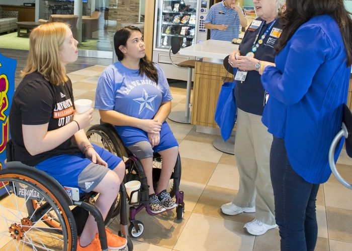 Movin' Mavs players Morgan Wood and Mikila Salazar visit with TR student accessibility resources staff after the event Oct. 4 on TR Campus.