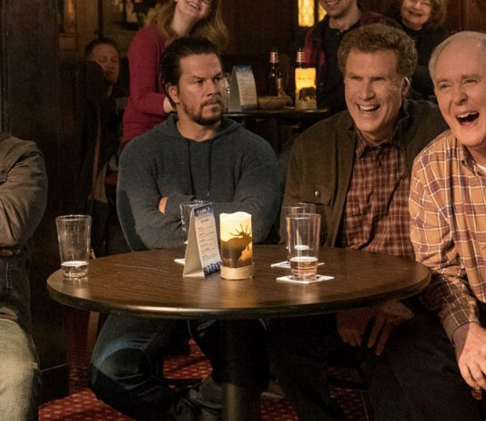 "Kurt (Mel Gibson), Dusty (Mark Wahlberg), Brad (Will Ferrell) and Don (John Lithgow) sit together as they watch an improv group perform on their ""dads night out"" in Daddy's Home 2."