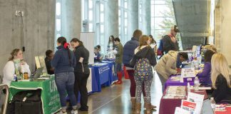 Students talk with representatives from various colleges and universities at the Health Professions Transfer Fair Nov. 8 at TREC. The fair focused on respiratory care, nursing, radiologic technology and other health care fields.