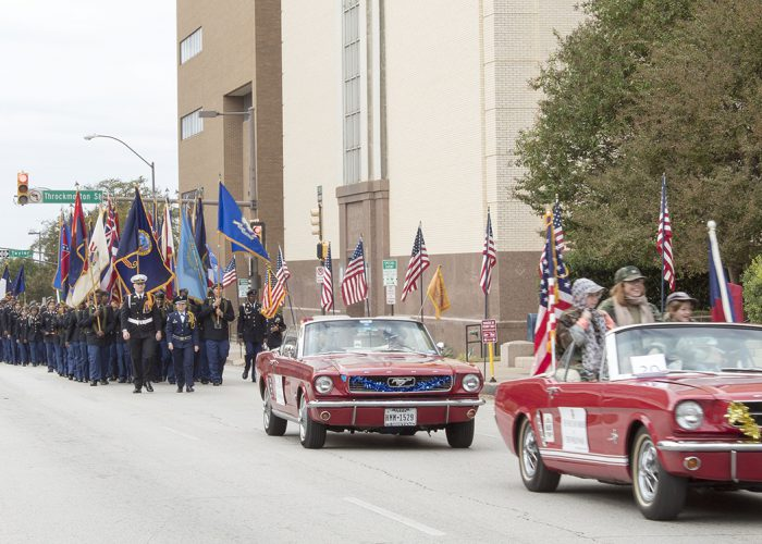 The annual Fort Worth Veterans Day Parade makes its way through downtown Fort Worth Nov. 11. TR students provided a table with snacks and water before the parade began.