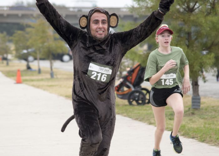 SE psychology professor Jose Velarde wore a monkey suit when he ran in the 5K race.