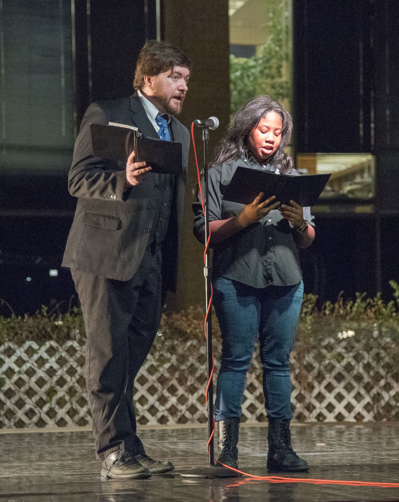 "NE Speech Club members Arther Fisher and Jade Jeffrey read Langston Hughes' poem ""Let America be America Again"" at the Harmony event Nov. 15 on NE Campus."