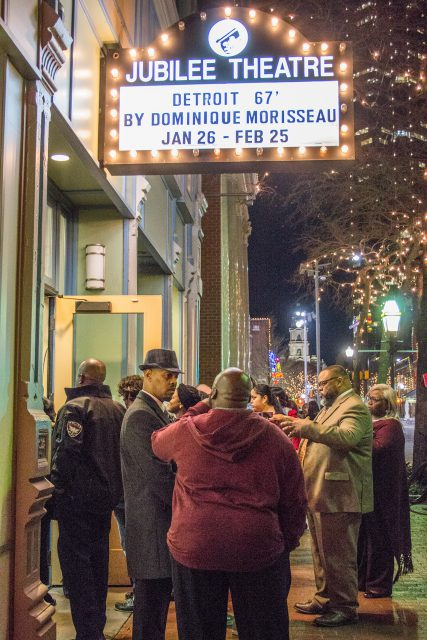 Attendees gather outside the historic Jubilee Theatre and wait to be seated for a private production of Detroit '67 after dinner and a discussion on campus.