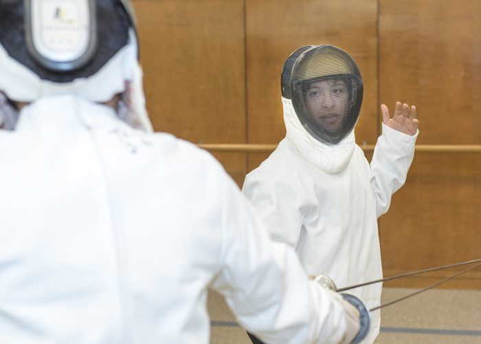 South student Joshua Padilla free fences foil against ECHS student Julio Aguero during a Fencing Club practice Feb. 7.