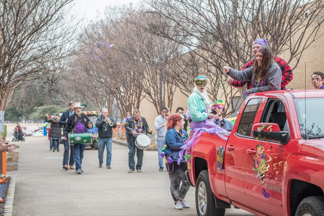Campus instructors act as a second line band as they played during the parade Feb. 13.