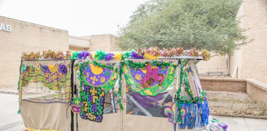 Photos by Suzann Clay/The Collegian NE student activities shows off its custom-made float for the Mardi Gras parade that crossed the campus Feb. 13. The parade has become an annual tradition on campus.