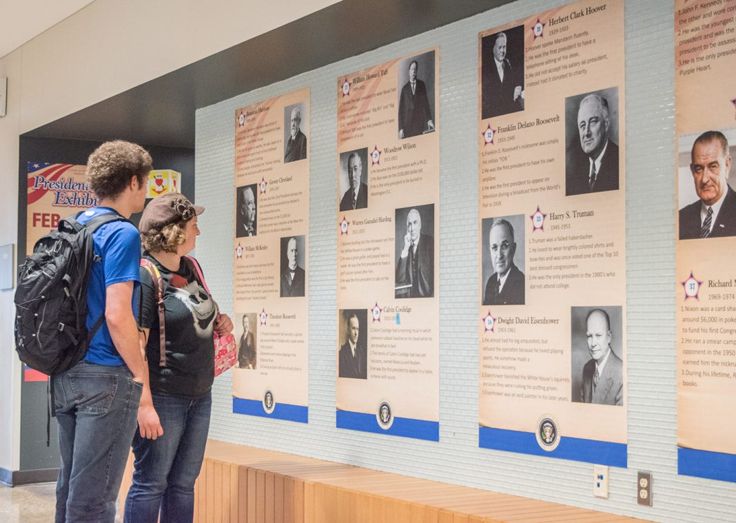 SE students Emily and Leon Nibarger take time to look at the Presidents Day exhibit on campus Feb. 20. The exhibit was SE's way of celebrating the holiday.