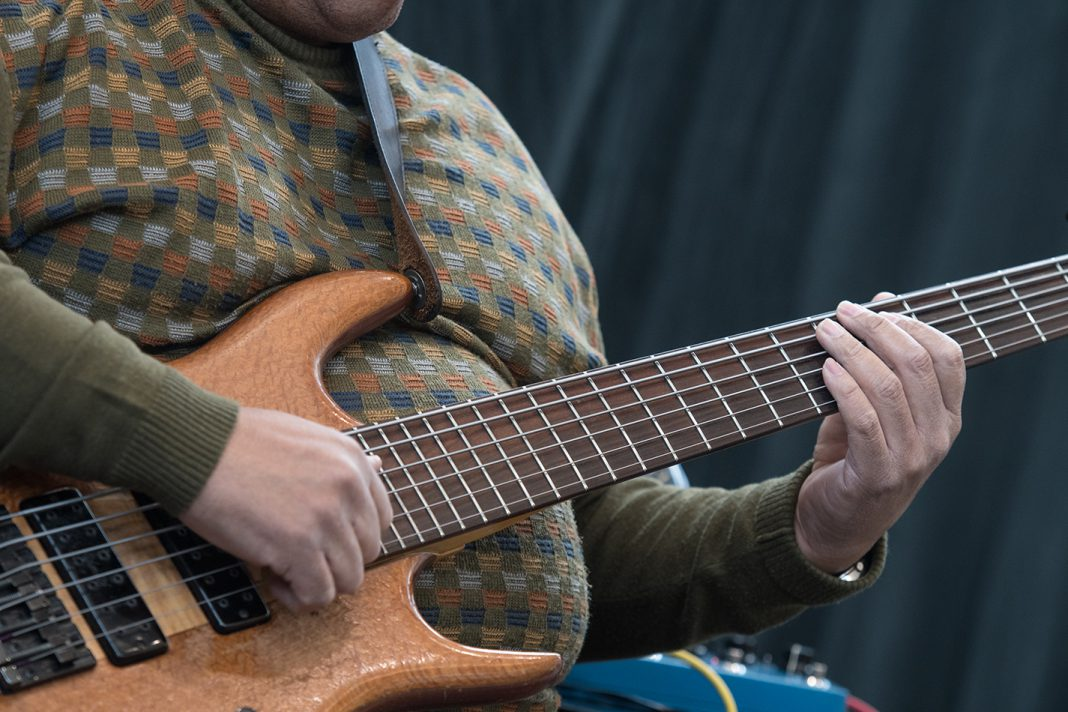Walter Nelson strums his bass guitar while performing with his group Linny Nance & Network on TR Campus Feb. 13.