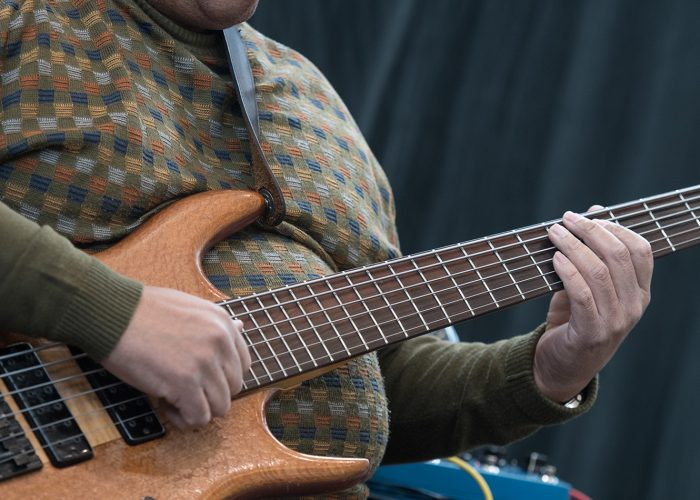Photos by Peter Matthews/The Collegian Walter Nelson strums his bass guitar while performing with his group Linny Nance & Network on TR Campus Feb. 13.