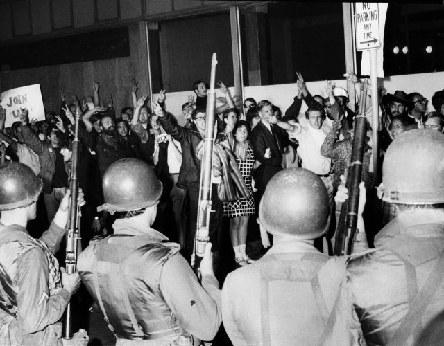 The National Guard meets angry protesters at the Democratic National Convention in 1968. Unrest came after the assassinations of Robert Kennedy and Martin Luther King Jr.