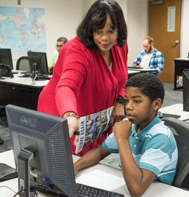 SE instructor Katrina Brown aids coding student Xabe Cole with an assignment in the Python coding class on SE Campus.