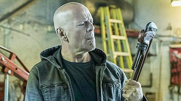 Dr. Paul Kersey (Bruce Willis) considers whether a wrench is the best tool to dole out his revenge in Death Wish.