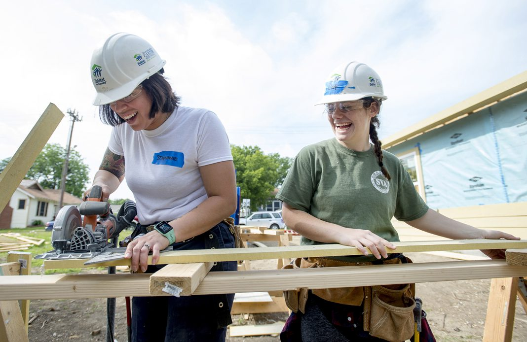 South students Stephanie Clements and Caitlin Lewis help give back to the community while working toward building a home for someone in need. NE students can volunteer to help out in the community during the campus' Big Day of Service April 2.