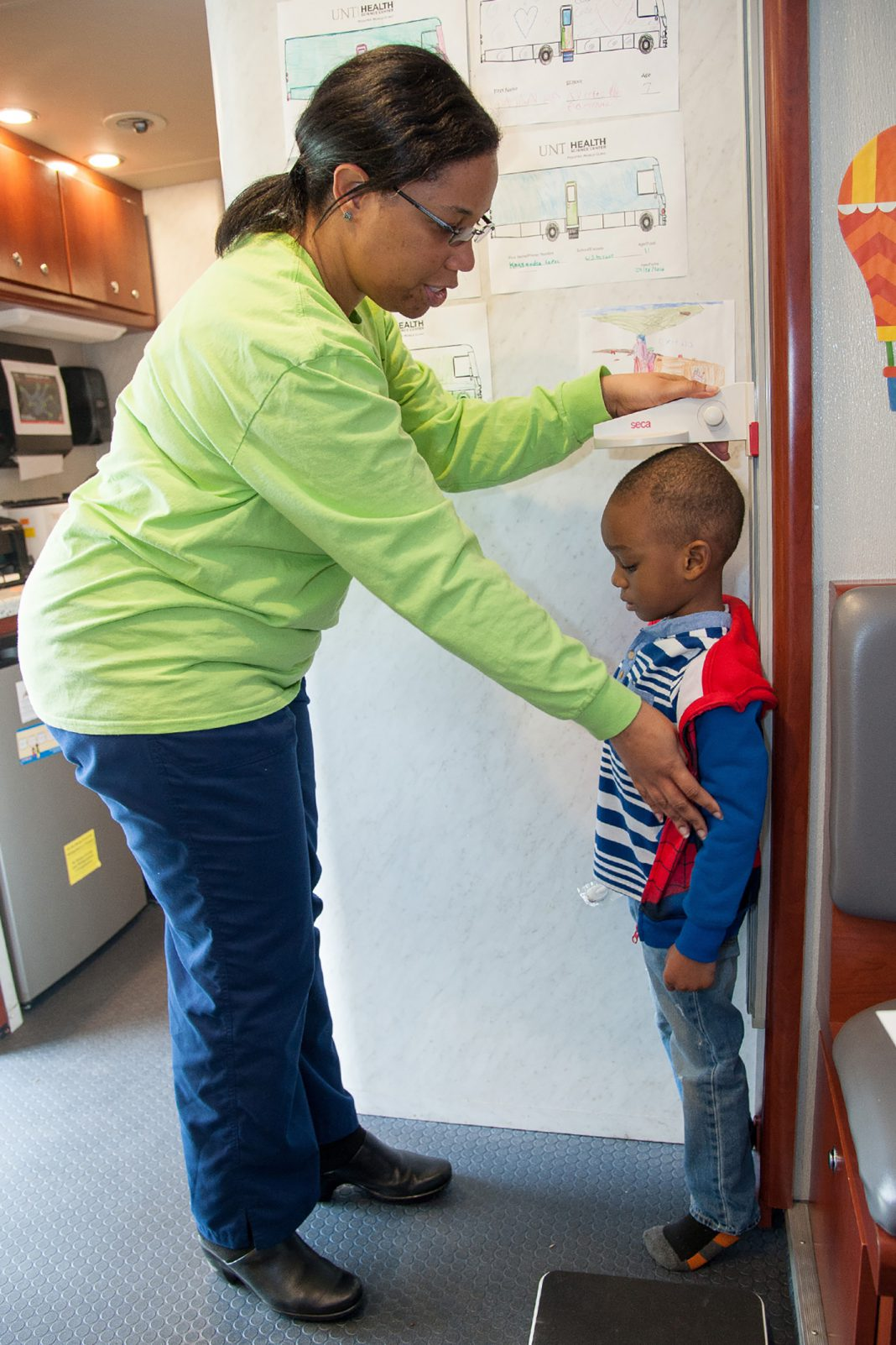 A young child attending last year's African-American Health Expo is measured for his height. This year's expo will be April 21 on South.